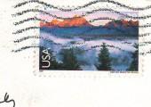 """Марка на почтовой открытке из США """"Форт Коллинз"""""""